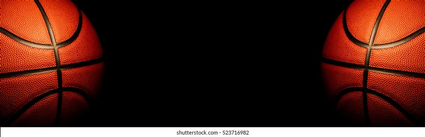 Basketball on a black background. panoramic or with blank space