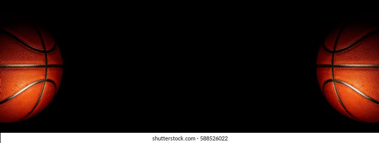 Basketball on a black background. - panoramic
