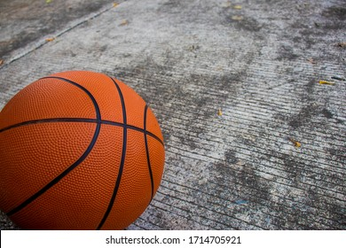 Basketball on the cement ground.