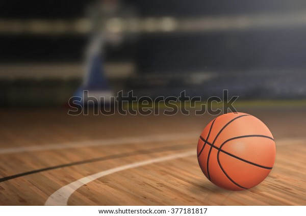 Basketball on Court Floor close up with blurred arena in background