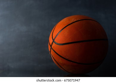 Basketball on a dark background.