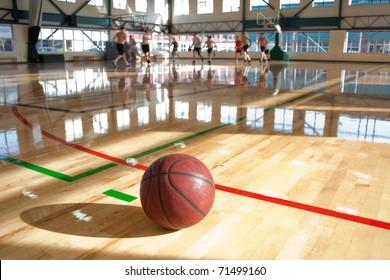 basketball on floor beside game action