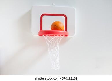 basketball on hoop,Basketball basket with all going through net.