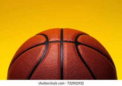 basketball on yellow background.