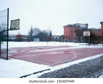 Basketball outdoor playground with snow