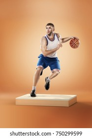 Basketball player in action with ball on orange background