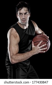 Basketball player with a Black uniform on a black background.