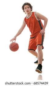 Basketball player dribbling the ball. Isolated on white