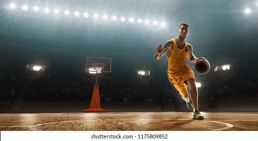 Basketball player drives a ball