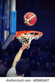 basketball player during the crushing of the basket with the basketball ball