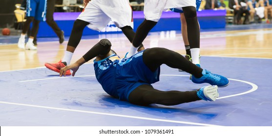 Basketball player falls on the court