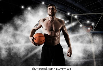 Basketball player holding ball in gym. Basketball concept