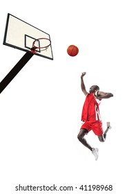 basketball player jump with ball towards basket