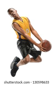 Basketball player jumping isolated over white background