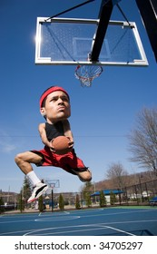 A basketball player with a large head driving to the hoop with some fancy moves.