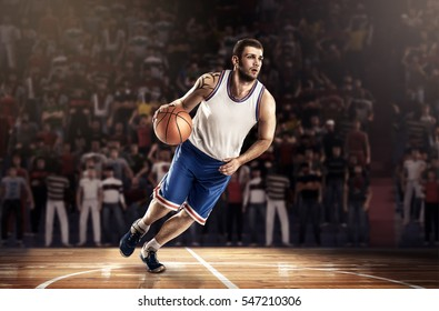 basketball player in light on professional court running with ball