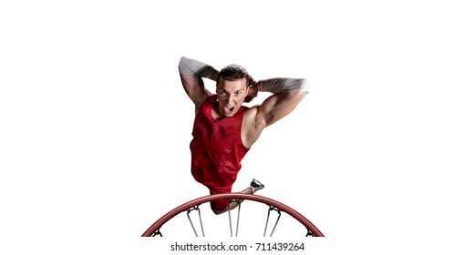 Basketball player make slum dunk on a white background. Isolated basketball player in unbranded clothes.