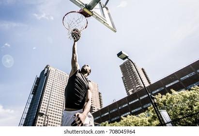 Basketball player making huge slam dunk