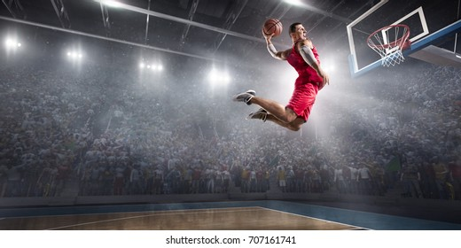 Basketball player on big professional arena during the game. He is wearing unbranded clothes.