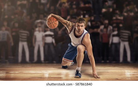 basketball player on court with ball in lights