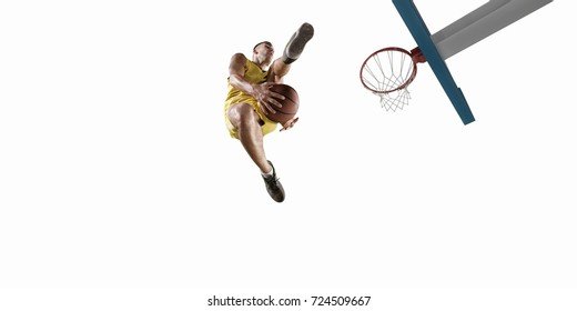 Basketball player on a white background make slam dunk. Isolated basketball player in unbranded clothes.