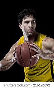 Basketball player on a  yellow uniform, on a black background.