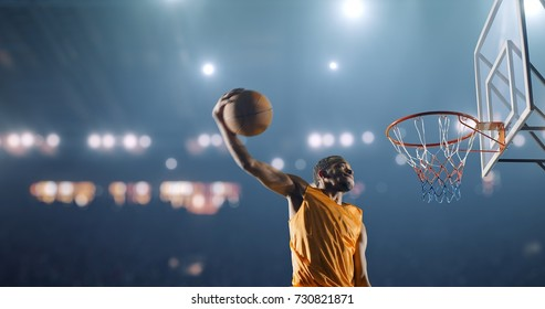 Basketball player performs a slam dunk on a sport background