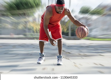basketball player playing with ball. motion blur effect on background