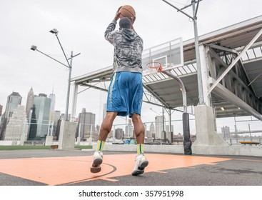 Basketball player playing on the court. Concept about sport and wellness