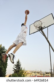 basketball player practicing and posing for basketball and sports athlete concept