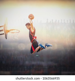 Basketball Player scoring an athletic, action slam dunk