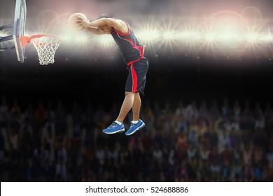 Basketball player scoring  an athletic during match