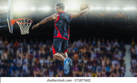Basketball Player scoring an athletic slam dunk shoot