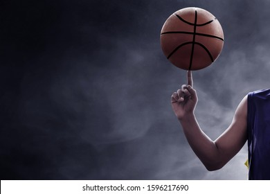 Basketball player spinning a ball
