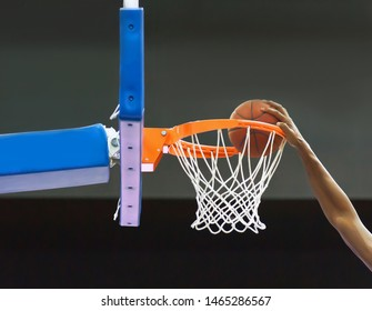 Basketball player throws the ball into the hoop