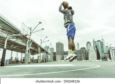 Basketball player training on New york pier 1 courts. concept about sport and people