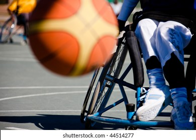 Basketball player in the wheelchair, motion blur on ball