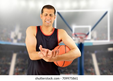 basketball player with a wrist injury at stadium