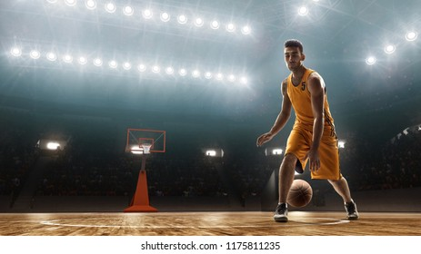 Basketball player in yellow uniform on a court