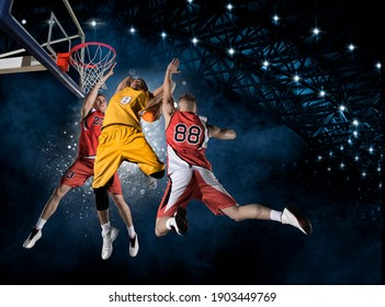 Basketball players in action in arena. Blocked shot. Two image of the same model