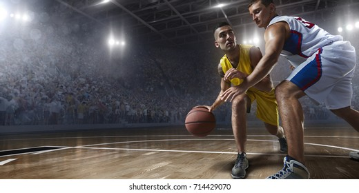Basketball players on big professional arena during the game. Players are wearing unbranded clothes.