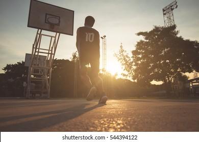 Basketball players playing basketball outdoor, vintage tone