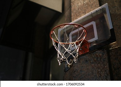 a basketball post on a marble wall
