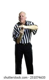 Basketball referee signaling a technical foul