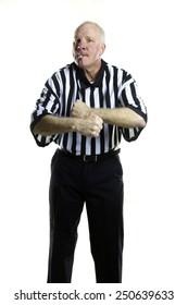 Basketball referee signaling a Traveling foul