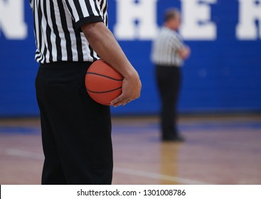 basketball referees during timeout