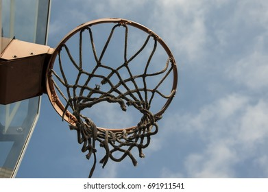 basketball rim and net under the blue sky