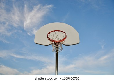 Basketball ring with net in a beautiful day