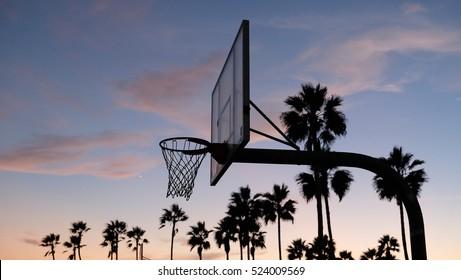Basketball ring at sunset