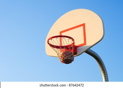 A basketball shot swishes through the net